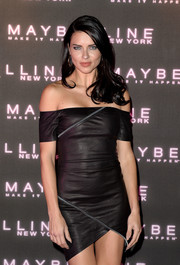 Adriana Lima looked fierce in a black off-the-shoulder leather dress by RtA during Maybelline's Bring on the Night party.