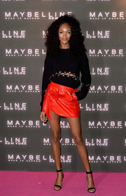 Jourdan Dunn went flirty on the bottom half in a shiny bow-adorned mini skirt.