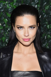 Adriana Lima looked edgy-glam wearing this sleek, partless hairstyle at the Maybelline NYFW welcome party.