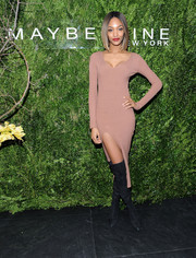 Jourdan Dunn added extra punch with a pair of black thigh-high boots.
