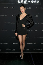 Adriana Lima complemented her dress with black crystal-buckle pumps by Roger Vivier.