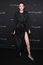 Gigi Hadid kept it low-key in a slouchy black blazer at the Maybelline x V Magazine party.