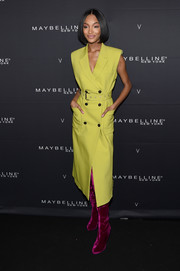 Jourdan Dunn's magenta thigh-high boots and yellow dress were a vibrant pairing!