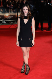 Kaya Scodelario was '60s-chic in a black Louis Vuitton cutout dress with embellished pocket flaps at the 'Maze Runner: The Death Cure' UK fan screening.