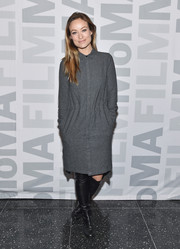 "Olivia Wilde kept it conservative in a loose, long-sleeve gray shirtdress at the 'Meadowland"" New York screening and Q&A."