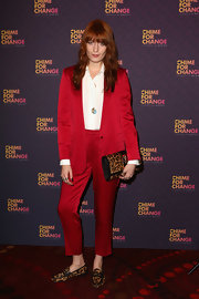 Florence Welch put to rest any rumors that redheads can't wear red when she sported this super sleek red suit.