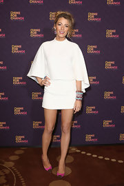 Blake Lively looked totally chic in this white mini frock with a matching cape.