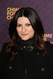 Laura Pausini's soft waves had a delicate romantic touch on the red carpet.