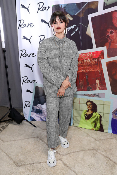 Selena Gomez went matchy-matchy, pairing her shirt with gray print pants.