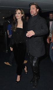 Angelina stepped out in Paris in a pair of timeless black pumps. She paired the classic heels with velvet pants and a sequin top in her signature color, black.