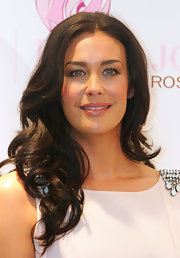 Megan Gale looked very girly at the New Women's Health Initiative event with her high-volume curly 'do.