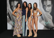 Megan Gale donned an elegant pair of print pants in two shades of blue during an Isola Swimwear event.