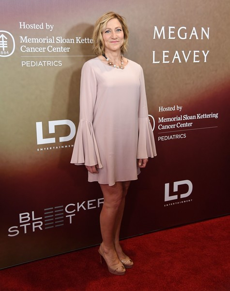 Edie Falco styled her dress with nude slingback peep-toes.
