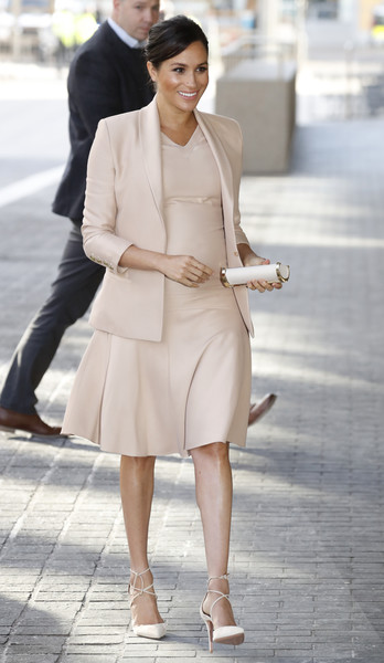 Meghan Markle Maternity Dress [duchess of sussex visits the national theatre,the duchess,fashion model,clothing,white,fashion,street fashion,shoulder,lady,beige,snapshot,beauty,the national theatre,duchess,sussex,england,london,patron,meghan,patronages]