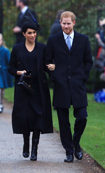 Meghan Markle Wool Coat [the royal family attend church on christmas day,suit,coat,fashion,outerwear,standing,academic dress,formal wear,gentleman,tuxedo,girl,harry,meghan markle,service,sussex,duchess,estate,church of st mary magdalene,christmas day church,wedding,meghan duchess of sussex,prince harry,wedding of prince harry and meghan markle,british royal family,united kingdom,house of windsor,christmas day,catherine duchess of cambridge]