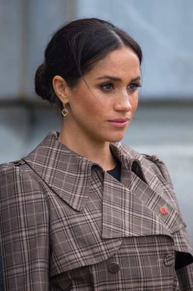 Meghan Markle Classic Bun [hair,hairstyle,fashion,plaid,beauty,lady,lip,black hair,design,pattern,harry,meghan markle,sussex,new zealand,duchess,war memorial,uk,cities,duke and duchess of sussex,visit,meghan duchess of sussex,wedding of prince harry and meghan markle,duke of sussex,british royal family,lighting designer,page six,royal family,mailonline,prince harry]