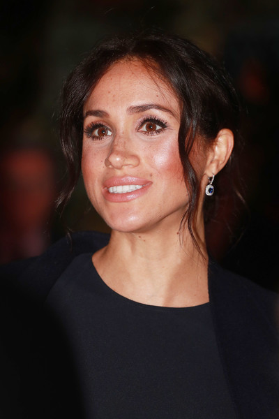 Meghan Markle Messy Updo [hair,face,eyebrow,hairstyle,chin,beauty,lip,smile,cheek,forehead,earring,meghan markle,harry,sydney,sussex,duchess,invictus games,reception,opening ceremony,wedding,meghan duchess of sussex,earring,wedding of prince harry and meghan markle,2017 invictus games,jewellery,birks group,cubic zirconia,everlane,coat]