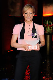 Helene Fischer kept it basic with a pink blouse and black slacks at the Mein Star des Jahres Awards.
