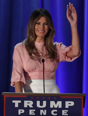 Melania Trump kept it sweet and ladylike in a pink Emilia Wickstead blouse with 3/4 blouson sleeves while campaigning in Pennsylvania.