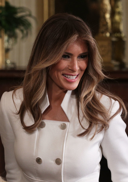 Melania Trump Feathered Flip [donald trump,melania trump,benjamin netanyahu,hair,beauty,lady,hairstyle,blond,outerwear,brown hair,smile,long hair,layered hair,joint press conference,news conference,time,talks,israeli,u.s.,east room of the white house]