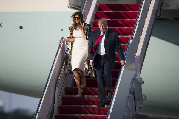 Melania Trump Printed Coat [best pictures of the day,red,fashion,dress,photography,wedding,ceremony,bride,stairs,suit,wedding dress,donald trump,melania trump,robert s. mueller iii,william p. bar,step,european,resort,us,west palm beach]