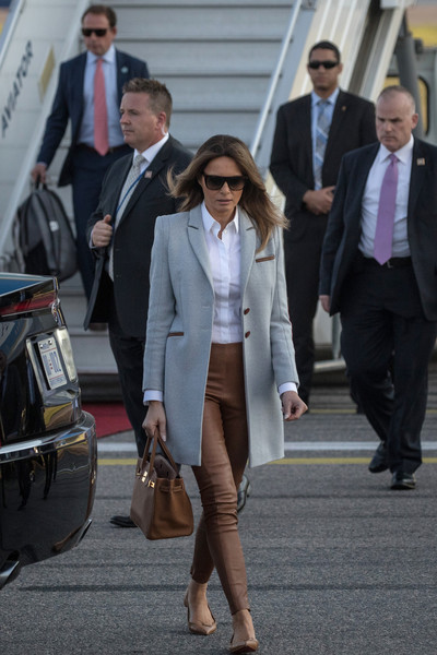 Melania Trump Wool Coat [clothing,street fashion,suit,fashion,blazer,footwear,outerwear,snapshot,formal wear,white-collar worker,vladimir putin,trump,melania trump,robert mueller,president,russia,u.s.,helsinki international airport,trump arrives in finland for talks with,talks]