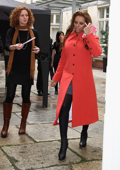 Melanie Brown Ankle Boots [clothing,red,fashion,street fashion,overcoat,coat,pink,trench coat,outerwear,standing,dvd,mel b,totally fit,mel b presents fitness,berlin,germany,park plaza,photocall]
