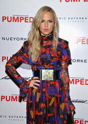 Rachel Zoe cinched in her loose jumpsuit with an oversized belt by Balmain when she attended Brian Atwood's celebration of PUMPED.