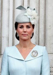 Kate Middleton donned a flower-adorned ice-blue hat by Sean Barrett for the RAF centenary event.