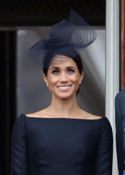 Meghan Markle accessorized with a swirly fascinator by Stephen Jones for the RAF centenary event.