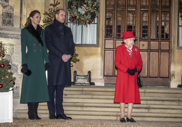 Kate Middleton paired a black velvet clutch with a green coat for a Windsor Castle event to thank volunteers and key workers.