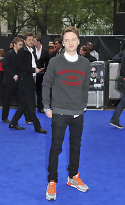 Conor arrived at the 'Men In Black' premiere wearing a gray crew neck sweater with red lettering.