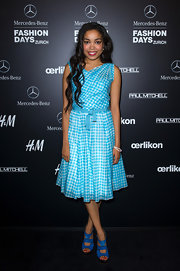 Dionne Bromfield looked adorable in a blue gingham print day dress at the Mercedes-Benz Fashion Days.
