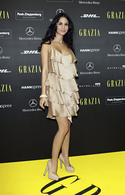Nude platform pumps like Sila Sahin's look perfect with just about any dress.