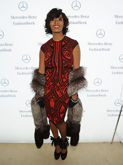 Toccara Jones attended the J. Mendel Fall presentation in a '50s-inspired outfit paired with a fur shawl.