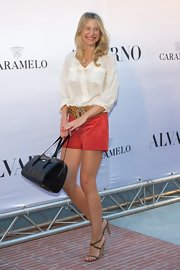 Maria rolled up the cuffs on her white silk shirt for an effortlessly relaxed look at the Alvarno Fashion Show in Madrid.
