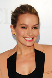 Becki Newton paired her gold stud earrings with a classic textured bun.