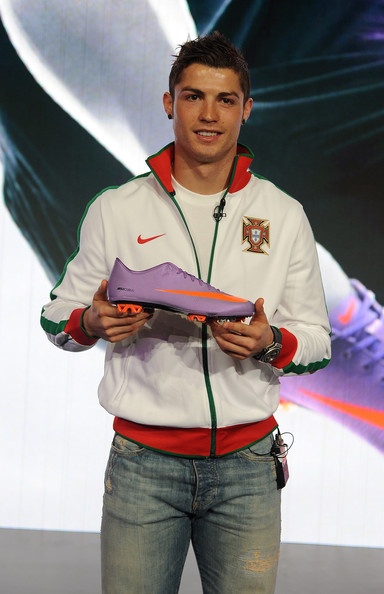 Cristiano makes his sponsor proud by sporting this white Nike track jacket at a press conference.