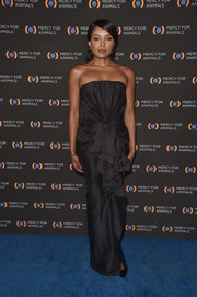 Kat Graham was all about classic glamour in a strapless black column dress at the Mercy for Animals 20th anniversary gala.