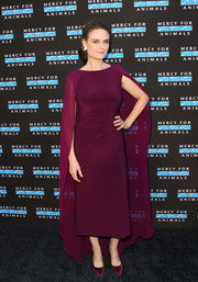 Emily Deschanel looked regal in a caped aubergine cocktail dress at the Hidden Heroes Gala.