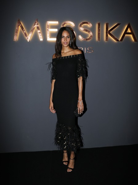 Cindy Bruna was the picture of elegance in a black off-the-shoulder dress with a feathered hem and sleeves at the Messika cocktail party.