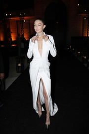 Gigi Hadid looked sharp and sexy in a plunging white gown by Brandon Maxwell at the Messika cocktail party.