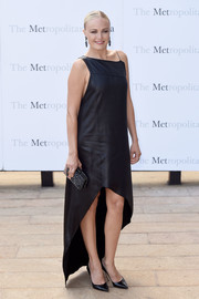 Malin Akerman went modern in a black dress with an asymmetrical neckline and a high-low hem at the Met Opera opening performance of 'Tristan und Isolde.'