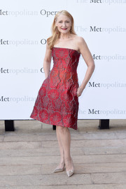 Patricia Clarkson made a chic appearance at the Met Opera opening performance of 'Tristan und Isolde' wearing this patterned red strapless dress.