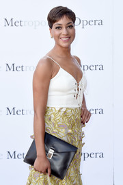 Cush Jumbo arrived for the Met Opera opening performance of 'Tristan und Isolde' carrying an edgy black envelope clutch.