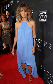 Halle Berry was beach-glam in a blue Halston Heritage halter dress with a high-low hem at the Black Women of Bond Tribute.
