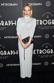 Chloe Sevigny donned an ankle-length silver turtleneck dress by J.W.Anderson for the Metrograph Theater 1st anniversary party.