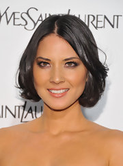 Olivia Munn spiced up her look with smoky shadow lightly rimmed around her lids.