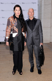 Marina Abramovic chose a mixed-print evening coat and a pair of black slacks for the 'Eugene Onegin' opening.