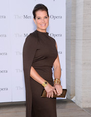 Brooke Shields added subtle shimmer to her look with a metallic gold croc-embossed clutch and layers of gold bracelets when she attended the 'Eugene Onegin' opening.